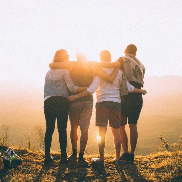 group hug in sunset